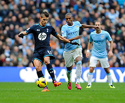 Tottenham Hotspur's Erik Lamela is chased down by Manchester City's Fernandinho - Photo mandatory by-line: Dougie Allward/JMP - Tel: Mobile: 07966 386802 24/11/2013 - SPORT - Football - Manchester - Etihad Stadium - Manchester City v Tottenham Hotspur - Barclays Premier League