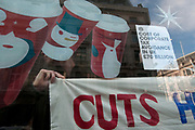 Vigo Street, off Regent Street, London.UK Uncut flashmob occuppy Starbucks to draw attention to the fact that they have paid no corporation tax for the last three years, and that the tax that rich companies haven't paid, would pay for the cuts the government is making to public services. Women are particularly affected by the cuts with refuges closing.