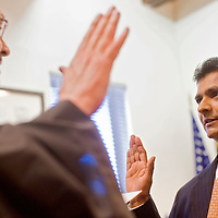 031413       Cable Hoover<br /> <br /> Newly-elected city councilor Yogash Kumar, right, is sworn in by Judge Grant Foutz at Gallup City Hall Thursday.