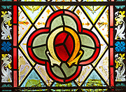 """Stained glass window floral geometric pattern flowers Greek letter omega, """"I am the Alpha and Omega"""", Easton Royal, Wiltshire, England, UK"""