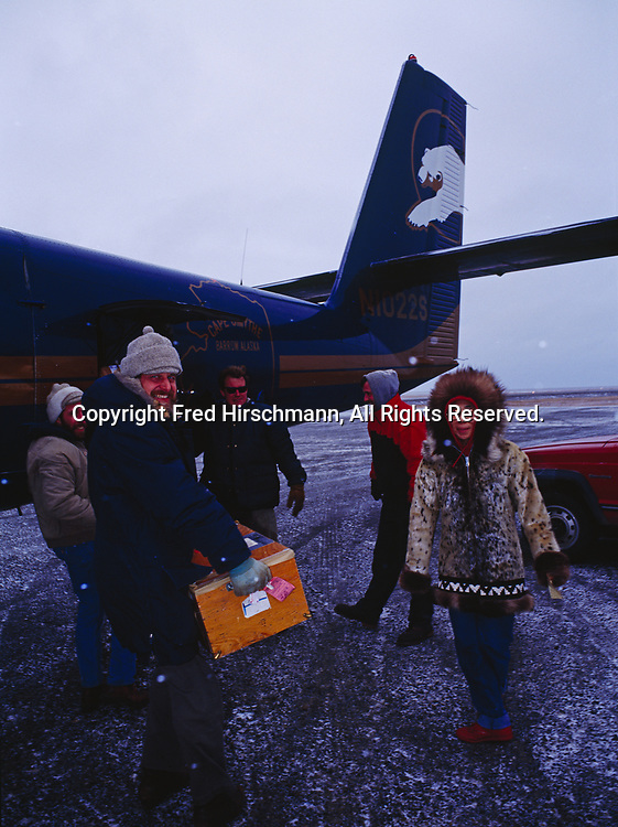 Freight and passengers loading on Cape Smythe Air's de Havilland DHC6 Twin Otter, Point Lay, Northwest Arctic Ocean Coast, Alaska.