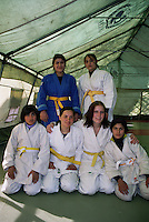 Norwegian judo trainers visiting Kabul, Afghanistan, as a part of tha Judo for fred (Judo for peace) program....- ....Norske judotrenere på besøk i Kabul, Afghanistan, ifm Judo for fred (JFF)....- ....The grils are training judo in a tent borrowed from UN....- ....Jentene trener i et telt som er utlånt fra FN....- ....Afghanistan's first femame judo yellow belts!!....-....Afghanistan første kvinnelige judo gulbelter!!....Back from left: Fahima and Fariba ..Front from left: Mariam, Asia, Dora Lisa (from Germany), Shazija..