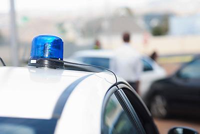 View of car accident scene from flashlights on police car (Credit Image: © Image Source/Albert Van Rosendaa/Image Source/ZUMAPRESS.com)