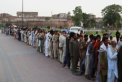 May 30, 2017 - Lahore, Punjab, Pakistan - A large number of faithful Muslims are seen standing in queue to get free food distributed at Historical greater Iqbal Park during Holy Fasting Month of Ramzan in Lahore. (Credit Image: © Rana Sajid Hussain/Pacific Press via ZUMA Wire)