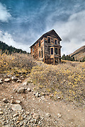 Animas Forks, a mining town high in the mountains east of Silverton, was founded in 1873, and was a ghost town by the 1920's.  At an altitude of 11,200 ft, it was brisk on this early October day.   In 1884, a blizzard dumped 25 feet of snow on the town, and cut off supplies for 23 days--tunnels had to be dug to connect buildings and residents.  When the mines played out, so did the town.  The Duncan Residence, was built in 1873 and featured a large bay window.