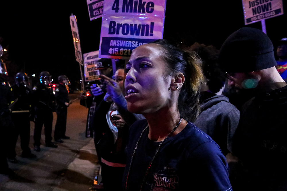 Shaunessy Thompson gathers with protesters, after a Ferguson grand jury's decision not to indict Ferguson, Missouri Police Officer Darren Wilson in the shooting death of Michael Brown, during a protest in Sacramento, Calif., Monday, November 24, 2014.