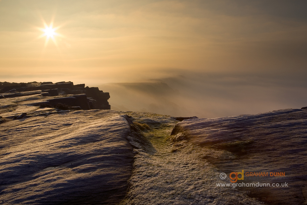 A spectacular temperature inversion from a frosty Curbar Edge. Baslow Edge can just be seen in the distance emerging from the mist. Peak District.