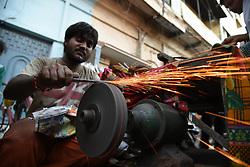 September 1, 2017 - Allahabad, Uttar Pradesh, India - Allahabad: An Indian shopkeeper sharp a knife on the eve of Eid al-Adha locally called bakreed celebration in allahabad on 01-09-2017. (Credit Image: © Prabhat Kumar Verma via ZUMA Wire)
