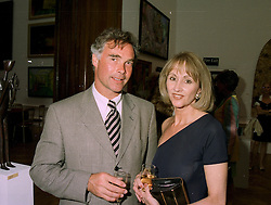 MR BARRY POLLEY and MRS SALLY BURTON widow of the actor Richard Burton, at an exhibition in London on 27th May 1997.LYR 31