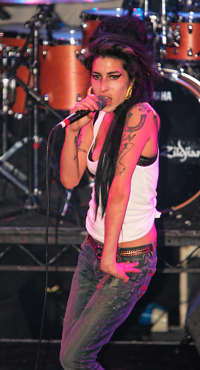 Singer Amy Winehouse, DOB=14/09/1983, performing for her gay fans at the G-A-Y Club. G-A-Y is London's biggest gay club and is held at the London Astoria nightclub, Soho, London, UK. Amy spent much of the show rubbing her itchy nose. She also seemed to have signs of old scars all down one arm...Picture Data:.Photographer: Edward Hirst.Copyright: ©2007 Licensed to Equinox News Pictures +448700 780000.Contact: Equinox Features.Date Taken: 20070415.Time Taken: 015002+0000.www.newspics.com