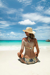 woman sitting on the beach, Koh Lipe, Thailand