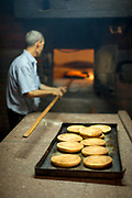 Rear view of baker preparing fresh bread in bakery, Casablanca, Morocco