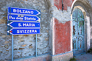 Signpost on The Stelvio Pass, Passo dello Stelvio, Stilfser Joch, in Northern Italy points to Bolzano, Santa Maria and Svizzera
