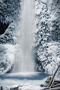 Marymere Falls, in Washington's Olympic National Park, covered in snow and ice during winter