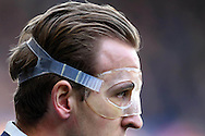 Harry Kane of Tottenham Hotspur looks on wearing a clear protective face mask. Barclays Premier league match, Tottenham Hotspur v Swansea city at White Hart Lane in London on Sunday 28th February 2016.<br /> pic by John Patrick Fletcher, Andrew Orchard sports photography.