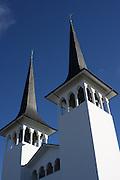 Looking up at the spires of the Háteigskirkja church in Reykjavik, Iceland.