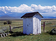 Two-holer, two-door outhouse at the Jones Cemetery, Centennial Valley, Montana.