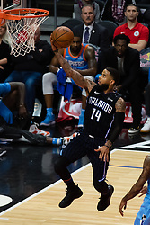 March 10, 2018 - Los Angeles, CA, U.S. - LOS ANGELES, CA - MARCH 10: Orlando Magic guard D.J. Augustin (14) goes for a layup during the game between the Orlando Magic and the LA Clippers on March 10, 2018, at STAPLES Center in Los Angeles, CA. (Photo by David Dennis/Icon Sportswire) (Credit Image: © David Dennis/Icon SMI via ZUMA Press)