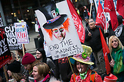 Peoples Assembly March for Health, Homes, Jobs and Education. End Austerity Now! march 16th April 2016 in London, United Kingdom. A plackard reads End the Madness. No more cuts. 50.000 thousand plus turned out to protest against the Conservative Government and their austerity policies and against tax evasions revealed in the Panama Papers.
