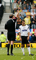 Photo: Steve Bond.<br />Derby County v Leeds United. Coca Cola Championship. 06/05/2007. Paul Peschisolido looks rueful as he is booked by referee Boyeson
