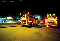 Stock photo of two Houston Fire Department trucks parked in the street at night