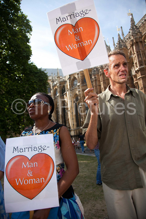 Christian opponents to the same sex marriage bill protest outside Parliament ahead of the third and final reading of the 'Marriage Bill 2012-13 to 2013-14' in the House of Lords.<br /> Summary of the Marriage (Same Sex Couples) Bill 2012-13 to 2013-14<br /> A Bill to make provision for the marriage of same sex couples in England and Wales, about gender change by married persons and civil partners, about consular functions in relation to marriage, for the marriage of armed forces personnel overseas, and for connected purposes.
