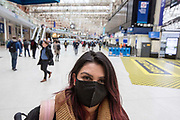 UNITED KINGDOM, London: 18 March 2020 <br /> A commuter walks through London Waterloo train station this morning wearing a mask in order to help prevent the spread of the Covid-19 virus. Train stations across the capital have seen the number of commuters dramatically drop as people are urged to work from home in order to try and keep the spread of the Covid-19 virus under control.