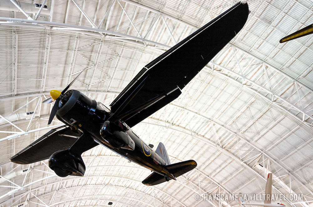 A propeller plane suspended from the ceiling on display at the Smithsonian National Air and Space Museum's Udvar-Hazy Center, a large hangar facility at Chantilly, Virginia, next to Dulles Airport and just outside Washington DC.