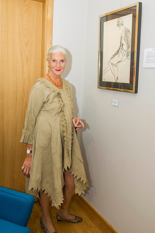 The original model poses with her illustration at the Private view for Drawing on Style: Four Decades of Elegance - an exhibition of original vintage fashion illustrations from Post War 1940s through to the 1970s organized by GRAY M.C.A, leading specialists in Fashion Illustration.  It includes more than 40 original works by some of the leading illustrators of the time from Britain, Europe and America including René Bouché, René Gruau and Carl Erickson for publications including Vogue as well as advertising work for L'Oreal and other famous names in Haute Couture.  There are also a selection of original designs by designers including Dior, Biba & Zandra Rhodes. Coinciding with London Fashion Week, the exhibition runs from Thursday 11th - Tuesday 16th September 2014 with prices from £300-£10,000. Gallery 8, St James's, London. 10 Sept 2014. Guy Bell, 07771 786236, guy@gbphotos.com
