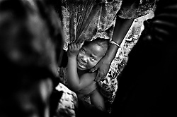 ive year-old Awa Balde clings to her mother moments after she was circumcised. The age at which girls are subjected to this ranges from when they are very small babies to young adulthood.