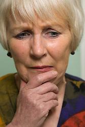 Portrait of an older woman looking worried,