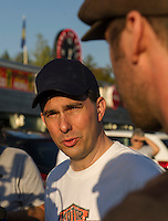 Republican Presidential candidate Scott Walker meets with reporters outside the Route 104 Diner in New Hampton Sunday evening on a stop of the Walker Harley Tour.  (Karen Bobotas/for the Laconia Daily Sun)