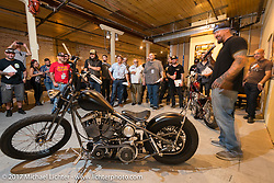 Custom builder Will Ramsay of Faith Forgotten choppers in the In Motion invitational bike show build to other builders and judges during the Lone Star Rally. Galveston, TX. USA. Friday November 3, 2017. Photography ©2017 Michael Lichter.