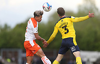 Blackpool's Kenny Dougall and Oxford United's Josh Ruffels<br /> <br /> Photographer Rob Newell/CameraSport<br /> <br /> Sky Bet League One Play-Off Semi-Final 1st Leg - Oxford United v Blackpool - Tuesday 18th May 2021 - Kassam Stadium - Oxford<br /> <br /> World Copyright © 2021 CameraSport. All rights reserved. 43 Linden Ave. Countesthorpe. Leicester. England. LE8 5PG - Tel: +44 (0) 116 277 4147 - admin@camerasport.com - www.camerasport.com
