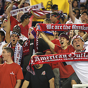 U.S. soccer supporters yell during a women's soccer International friendly match between Brazil and the United States National Team, at the Florida Citrus Bowl  on Sunday, November 10, 2013 in Orlando, Florida. The U.S won the game by a score of 4-1.  (AP Photo/Alex Menendez)