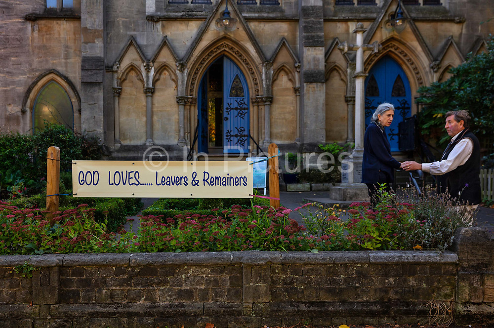 God loves...leavers and remainers,a message outside the church on 20th September 2019 in Highgate, London, United Kingdom. Two parishoners are conversing outside the Highgate URC Church during the crisis throughout the UK over BREXIT. After the 2017 reforendum on leaving Europe, Britain is now more divided than at any time in living memory. There are no quick fixes for the deep divisions Brexit has caused. Healing them will call for a quality of leadership that has been absent from British politics in recent years.