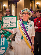 05 MARCH 2020 - ST. PAUL, MINNESOTA: SUZANN WILLHITE, from Minneapolis, cheers for the ERA during a rally in the rotunda at the Minnesota State Capitol. About 75 people, mostly women, came to the capitol to support ratification of the Equal Rights Amendment and mark the local observance of International Women's Day. International Women's Day is celebrated on March 8 around the world.     PHOTO BY JACK KURTZ