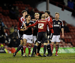 Brentford's Alan McCormack argues with Bristol City's Wade Elliott - Photo mandatory by-line: Dougie Allward/JMP - Tel: Mobile: 07966 386802 28/01/2014 - SPORT - FOOTBALL - Griffin Park - Brentford - Brentford v Bristol City - Sky Bet League One