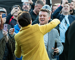 © Licensed to London News Pictures . 25/04/2019. Manchester, UK. ANNE MARIE WATERS and STEPHEN YAXLEY-LENNON (aka Tommy Robinson ) . Stephen Yaxley-Lennon announces he is running for a seat in the European Parliament in North West England at a barbecue event on a green on a housing estate in Wythenshawe , South Manchester . Photo credit: Joel Goodman/LNP