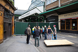 © Licensed to London News Pictures. 12/06/2017. London, UK. Sheets of wood are delivered to Borough Market as traders begin clearing up and prepare to reopen. The market was the scene of a terrorist attack on Saturday 3 June 2017 in which eight people were killed. Photo credit: Rob Pinney/LNP