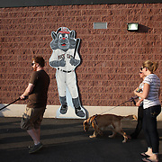 Fans arrive with their dogs for the 'Bark in the Park' owners with their dogs day during the New Britain Rock Cats Vs Binghamton Mets Minor League Baseball game at New Britain Stadium, New Britain, Connecticut, USA. 2nd July 2014. Photo Tim Clayton