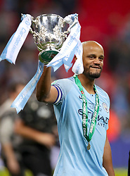 Manchester City's Vincent Kompany celebrates with the trophy after his side win the Carabao Cup Final in a penalty shot out