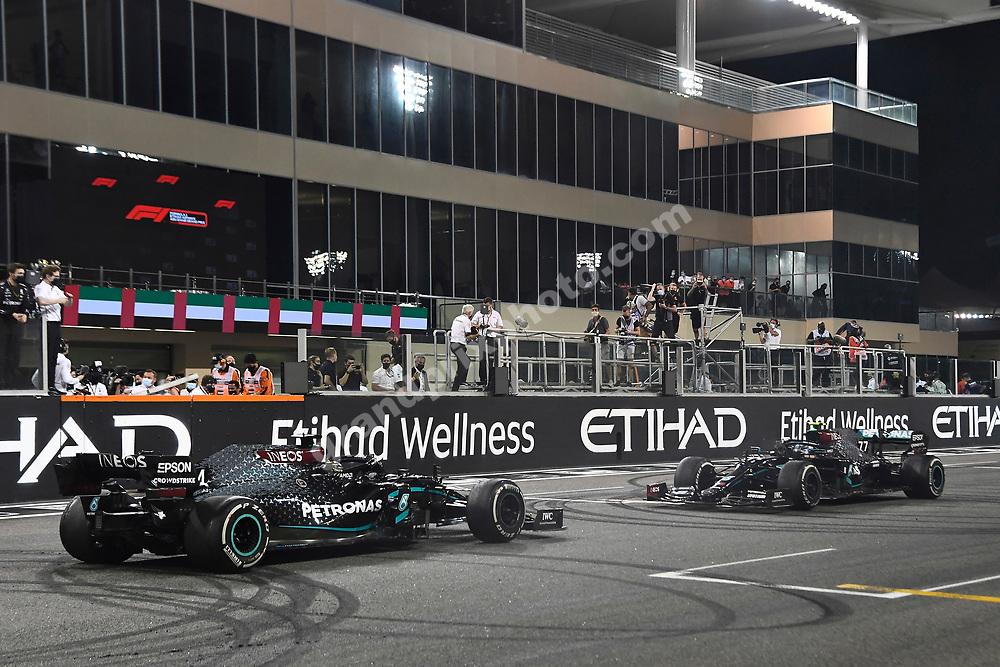 Lewis Hamilton and Valtteri Bottas (both Mercedes) aftervmaking donuts and smoke after the 2020 Abu Dhabi Grand Prix at the Yas Marina Circuit. Photo: Grand Prix Photo
