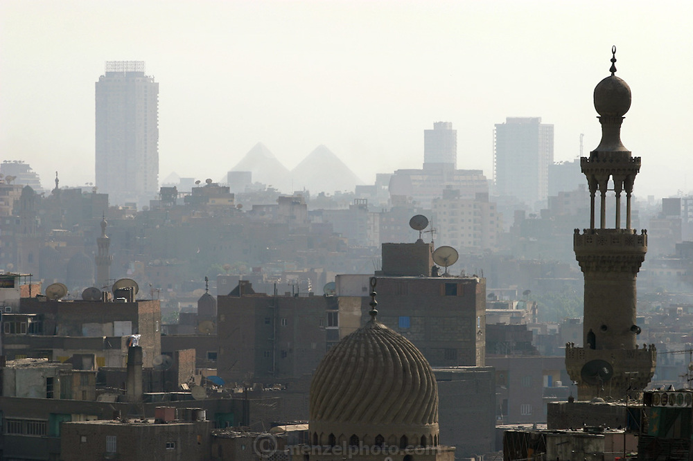 The pyramids of Giza seen through the dust, smoke and haze of Cairo Egypt from the minaret of a mosque. (Supporting image from the project Hungry Planet: What the World Eats.) .