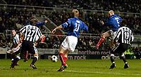 Photo. Jed Wee, Digitalsport<br /> Newcastle United v Valerenga, UEFA Cup 3rd Round, St. James' Park, Newcastle. 03/03/2004.<br /> Valerenga's Erik Hagen (5) scrambles home his team's equaliser.