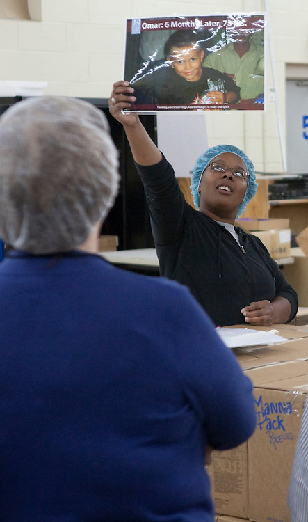 Avivah Brown from FMSC shares a story about Omar, a young food recipient, to let volunteers know the good their work is doing, Friday, April 9.