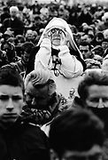 Pope's visit to France, September 1996. A nun looks at the Pope through binoculars. 200,000 people attend an open air mass at Reims