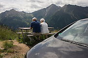 Elderly visitors admire the views from the roadside near the top of the Jaufenpass, the highest point at 2,094 metres on the road between Meran-merano and Sterzing-Vipiteno in South Tyrol, Italy.