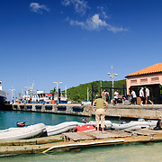 The inter-island ferry pulls up against the dock in Cruz Bay, St. John, in the US Virgin Islands. This is the main harbor and access point to St. John and from here ferries go to many destinations in the British and US Virgin Islands.