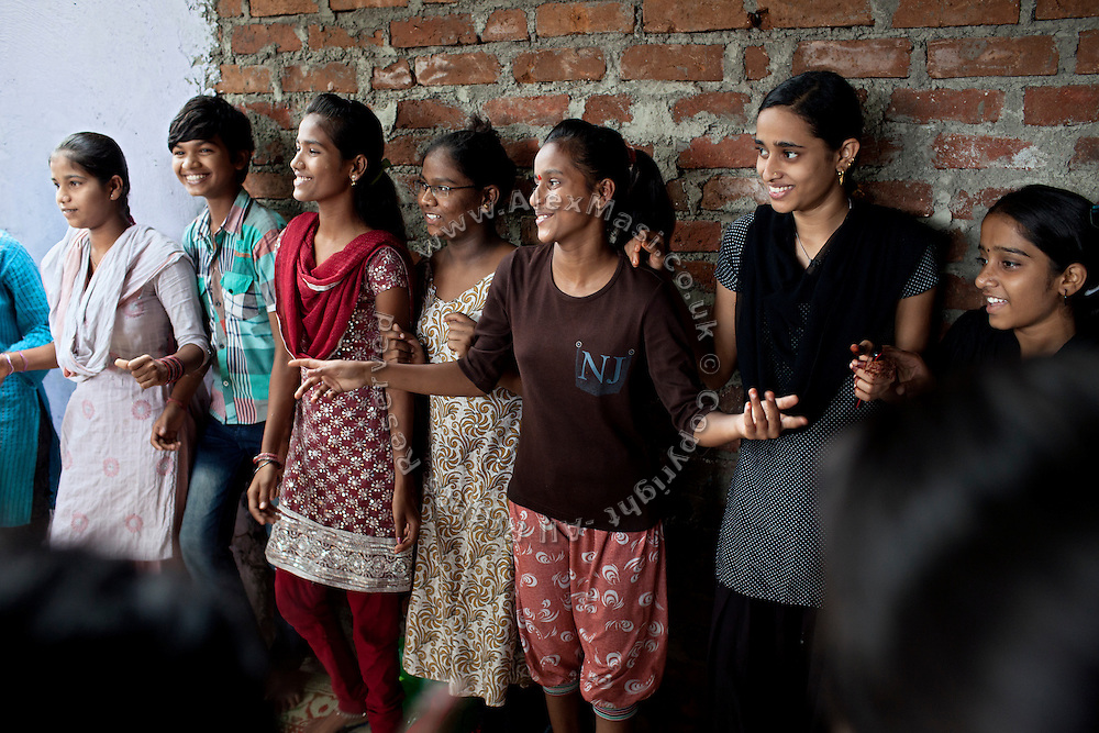 Mayuri Mahesh Pandit, 13, (centre-right) is participating to the Unicef-run 'Deepshikha Prerika' project inside the Milind Nagar Pipeline Area, an urban slum on the outskirts of Mumbai, Maharashtra, India, where she resides with her family.